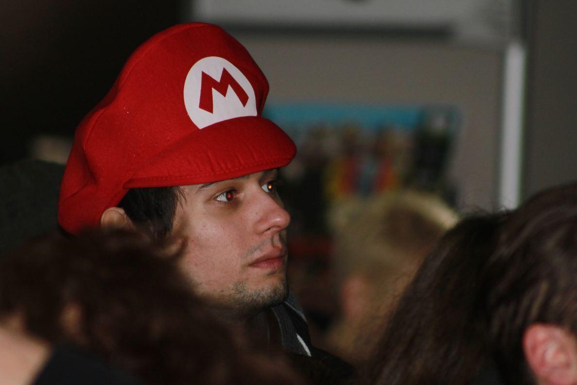 A fan of Mario waits in line to buy the console