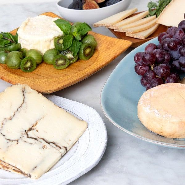 "<h2>Murray's Cheese Mother's Day Sampler</h2><br>This exclusive Mother's Day sampler includes six of Murray's most popular and luxurious cheeses. Add a bottle of wine and a few crackers for an ideal evening. <br><br><strong>Murray's Cheese</strong> Mother's Day Sampler, $, available at <a href=""https://go.skimresources.com/?id=30283X879131&url=https%3A%2F%2Fwww.murrayscheese.com%2Fmothers-day-collection"" rel=""nofollow noopener"" target=""_blank"" data-ylk=""slk:Murray's Cheese"" class=""link rapid-noclick-resp"">Murray's Cheese</a>"