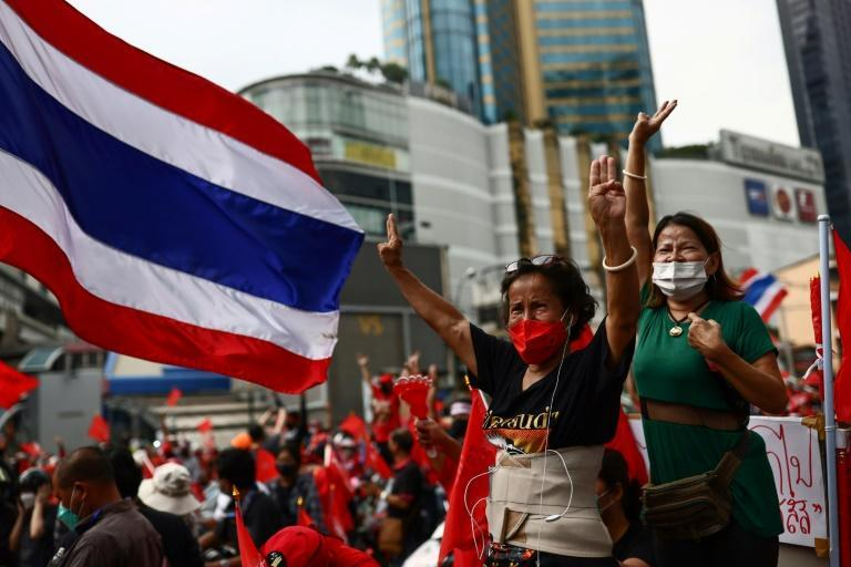 Hundreds of protesters drove through Bangkok's streets to mark the 15th anniversary of a military coup that ousted former premier Thaksin Shinawatra (AFP/Jack TAYLOR)