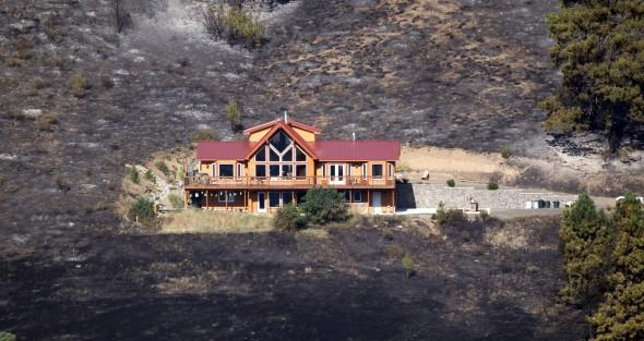 Home survives wildfire in Washington - AP Photo
