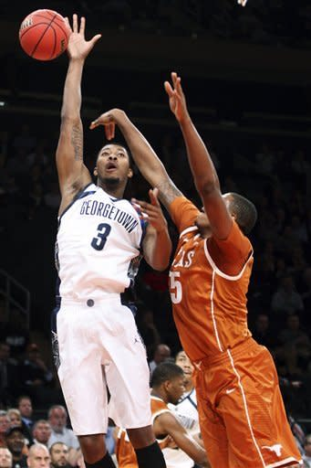 Georgetown's Mikael Hopkins (3) shoots over Texas' Cameron Ridley (55) during the first half of their NCAA college basketball game in the Jimmy V Classic, Tuesday, Dec. 4, 2012, at Madison Square Garden in New York. (AP Photo/Frank Franklin II)