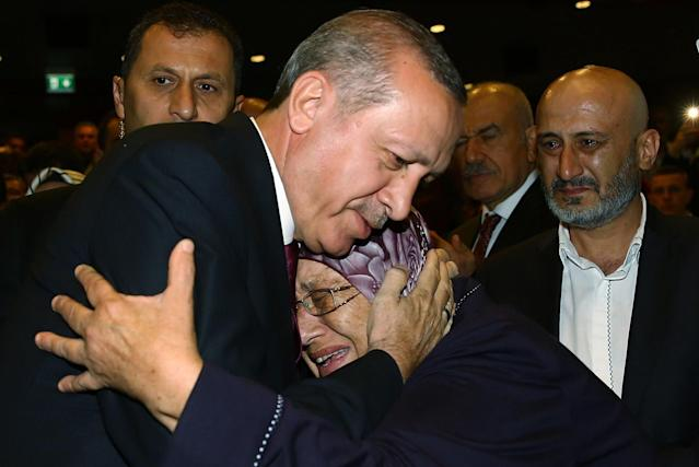 <p>Turkey President Recep Tayyip Erdogan hugs a woman during an event to honor those killed and wounded during the failed July 15 military coup, in Ankara, Turkey, late Friday, July 29, 2016. The government crackdown in the coup's aftermath has strained Turkey's ties with key allies including the United States. (AP Photo/Kayhan Ozer Presidential Press Service, via AP Pool) </p>