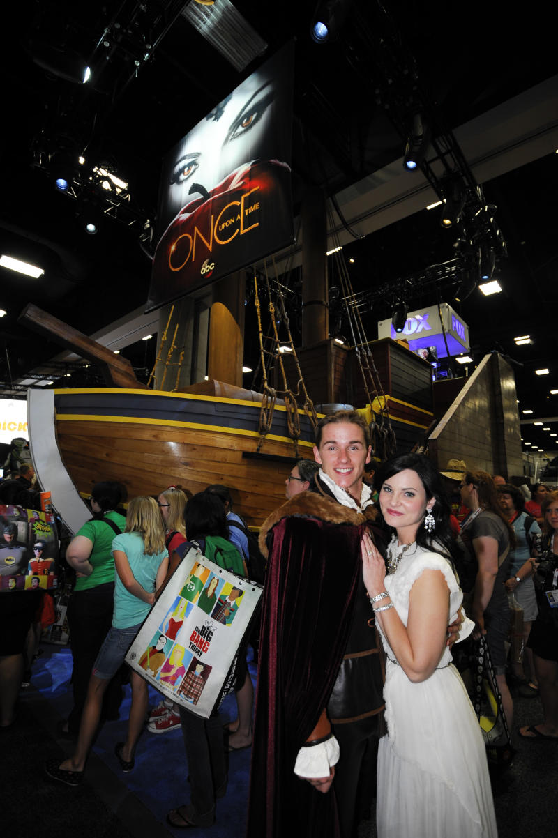 "Characters from ABC's ""Once Upon a Time"" pose in front their ship at the ABC booth during the Preview Night event on Day 1 of the 2013 Comic-Con International Convention on Wednesday, July 17, 2013 in San Diego. (Photo by Denis Poroy/Invision/AP)"