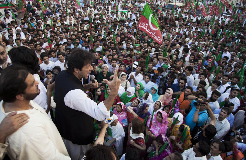 FILE - In this Monday, June 18, 2012 file photo, Pakistan's former cricket legend-turned politician Imran Khan addresses an anti-corruption rally in Islamabad, Pakistan. Corruption is so pervasive in Pakistan that even Osama bin Laden had to pay a bribe to build his hideout in the northwest where he was killed by U.S. commandos. (AP Photo/B.K. Bangash, File)