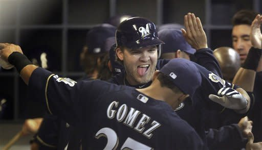 Milwaukee Brewers' Corey Hart celebrates with Carlos Gomez after Hart hit a two-run home run during the sixth inning of a baseball game against the Houston Astros on Tuesday, April 24, 2012, in Milwaukee. (AP Photo/Morry Gash)