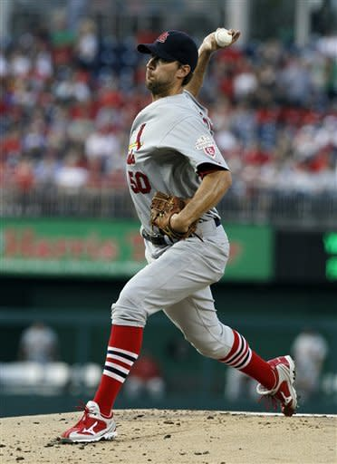 St. Louis Cardinals starting pitcher Adam Wainwright throws during the first inning of a baseball game against the Washington Nationals at Nationals Park Friday, Aug. 31, 2012, in Washington. (AP Photo/Alex Brandon)