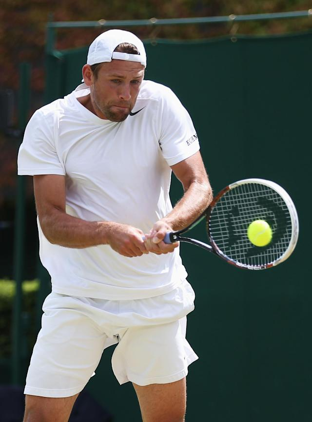 LONDON, ENGLAND - JULY 01: Lukasz Kubot of Poland plays a forehand during the Gentlemen's Singles fourth round match against Adrian Mannarino of France on day seven of the Wimbledon Lawn Tennis Championships at the All England Lawn Tennis and Croquet Club on July 1, 2013 in London, England. (Photo by Clive Brunskill/Getty Images)