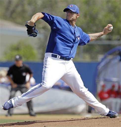 Toronto Blue Jays starting pitcher Brett Cecil winds up in the first inning of a spring training baseball game against the Philadelphia Phillies in Dunedin, Fla., Sunday, March 18, 2012. Toronto won 10-2. (AP Photo/Kathy Willens)