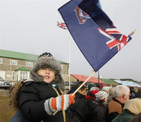 A child waves a Falklands flag in Stanley June 14, 2012, during commemorations for the 30th anniversary of the Falklands War.