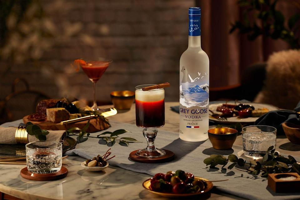 "Combine 40ml <a href=""https://www.amazon.co.uk/Grey-Goose-French-Vodka-70/dp/B003TJM57K/ref=sr_1_4?dchild=1&keywords=Grey+Goose&qid=1605624826&s=grocery&sr=1-4&tag=hearstuk-yahoo-21&ascsubtag=%5Bartid%7C1919.g.34687711%5Bsrc%7Cyahoo-uk"" rel=""nofollow noopener"" target=""_blank"" data-ylk=""slk:Grey Goose"" class=""link rapid-noclick-resp"">Grey Goose </a>vodka, 60ml fresh espresso and 20ml cardamom-cinnamon syrup (per 500ml: 2 tablespoons ground cardamom, 1 cinnamon stick, 500ml boiling water, 500g sugar) in a cappuccino mug. Top with frothed oat-milk and cinnamon dust.<br>"