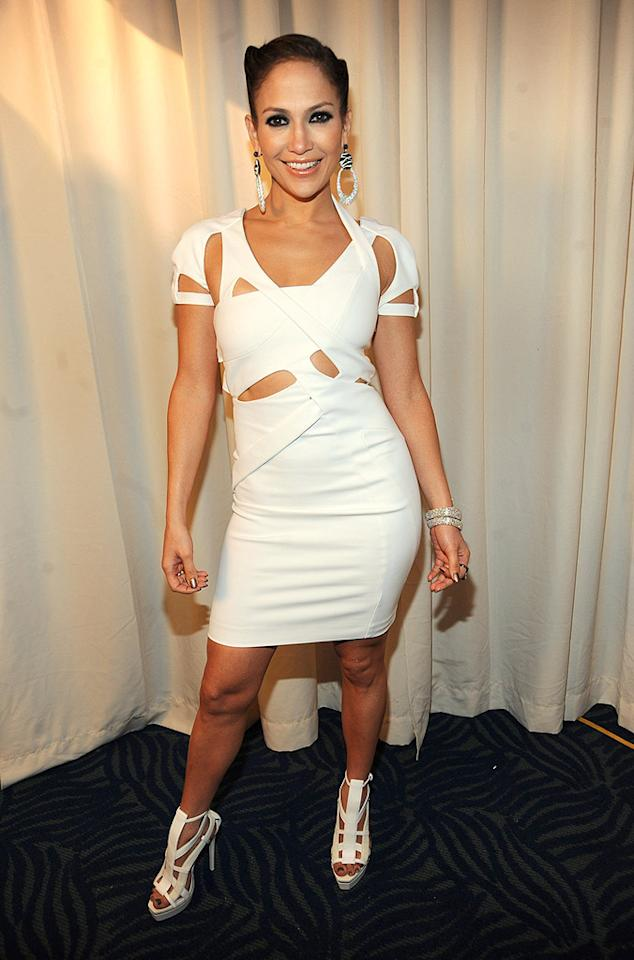 "Despite falling on her rear while performing ""Louboutins"" at the American Music Awards, Jennifer Lopez pulled herself together backstage and ended up looking like a million bucks in a curve-enhancing cut-out dress courtesy of Gucci. Kevin Mazur/<a href=""http://www.wireimage.com"" target=""new"">WireImage.com</a> - November 22, 2009"