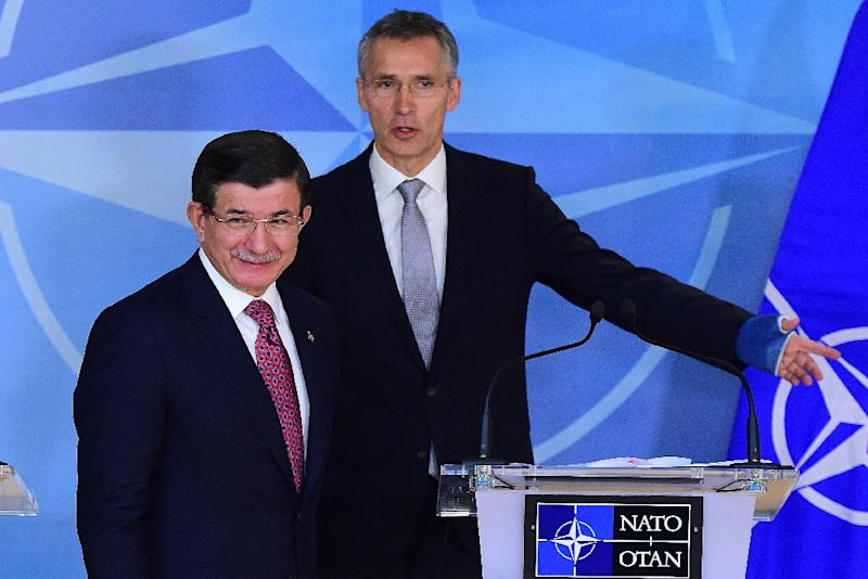 "Turkish Prime Minister Ahmet Davutoglu, pictured at left with NATO Secretary-General Jens Stoltenberg on November 30, 2015, said Ankara was ""protecting our airspace' in shooting down a Russian warplane and would not apologize for ""doing our duty"" (AFP Photo/Emmanuel Dunand)"
