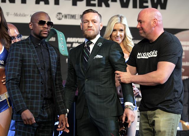 Dana White, far right, with Floyd Mayweather and Conor McGregor during their boxing promotion. (Getty)