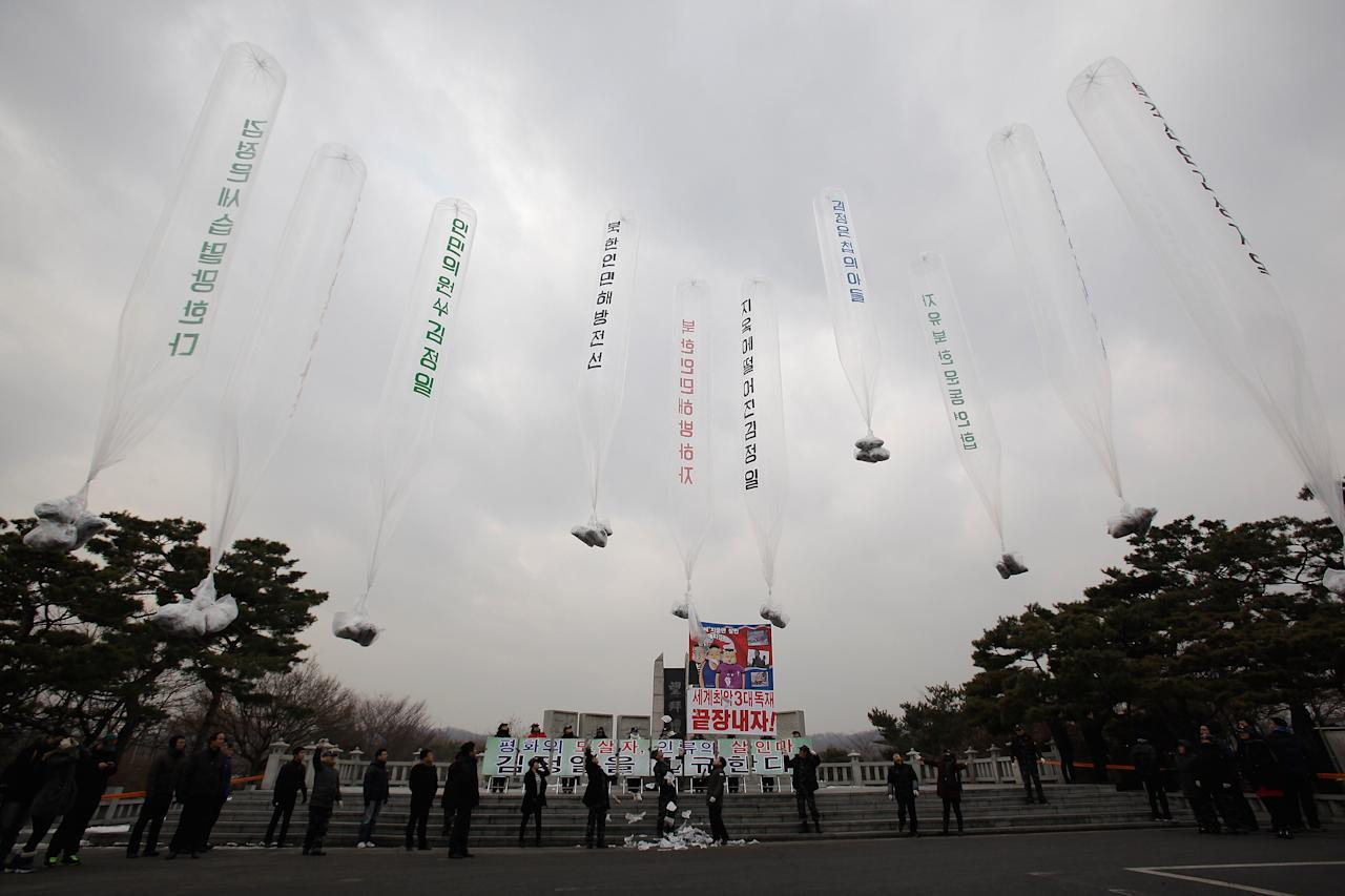 PAJU, SOUTH KOREA - DECEMBER 28:  North Korean defectors, now living in South Korea, release balloons carrying propaganda leaflets denouncing North Korea's late leader Kim Jong-Il at Imjingak, near the Demilitarized zone (DMZ) separating South and North Korea on December 28, 2011 in Paju, South Korea. North Koreans are today farewelling their former leader Kim Jong-Il with his funeral taking place in Pyongyang. Kim died suddenly from a heart attack on December 17, aged 69.  (Photo by Chung Sung-Jun/Getty Images)