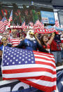 U.S. fans stand for the national anthem before the team's CONCACAF Gold Cup soccer match against Canada in Kansas City, Kan., Sunday, July 18, 2021. (AP Photo/Colin E. Braley)