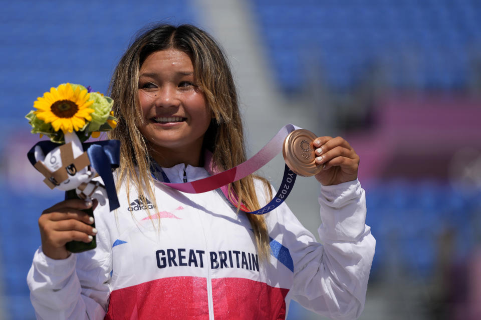 Sky Brown of Britain poses with her bronze medal in the women's park skateboarding at the 2020 Summer Olympics, Wednesday, Aug. 4, 2021, in Tokyo, Japan. (AP Photo/Ben Curtis)