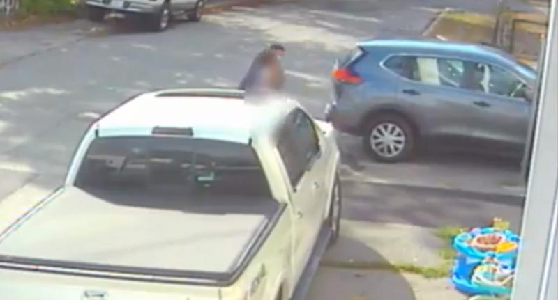 Pictured is a still from the CCTV footage of a man grabbing a young girl. Source: Providence PD
