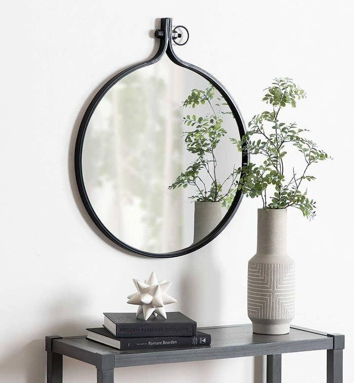 """This piece has an embroidery hoop-turned-mirror vibe that's ~sew~ cool you're gonna want it hanging around your place forever!<br /><br /><strong>Promising review:</strong>""""I purchased two of these mirrors for a recent master bathroom remodel.<strong>They are perfect! The color of the metal is really pretty, and they have the right amount of a rustic look.</strong>They were easy to hang and fit really nicely over each sink of the double sink vanity. The price was great as I had seen others that looked similar but were more expensive."""" —<a href=""""https://www.amazon.com/gp/customer-reviews/R2IQ3AGI95P19Z?&linkCode=ll2&tag=huffpost-bfsyndication-20&linkId=eeb45ff441478850aa12926153212af2&language=en_US&ref_=as_li_ss_tl"""" target=""""_blank"""" rel=""""nofollow noopener noreferrer"""" data-skimlinks-tracking=""""5854435"""" data-vars-affiliate=""""Amazon"""" data-vars-href=""""https://www.amazon.com/gp/customer-reviews/R2IQ3AGI95P19Z?tag=bfmal-20&ascsubtag=5854435%2C3%2C37%2Cmobile_web%2C0%2C0%2C16324241"""" data-vars-keywords=""""cleaning"""" data-vars-link-id=""""16324241"""" data-vars-price="""""""" data-vars-product-id=""""20942657"""" data-vars-product-img="""""""" data-vars-product-title="""""""" data-vars-retailers=""""Amazon"""">Darcy Deloach</a><br /><br /><strong>Get it from Amazon for<a href=""""https://www.amazon.com/Kate-Laurel-Industrial-Rustic-Diameter/dp/B07B4JPV9X?&linkCode=ll1&tag=huffpost-bfsyndication-20&linkId=9603f9e50423cfdf0db7a1977d9e9652&language=en_US&ref_=as_li_ss_tl"""" target=""""_blank"""" rel=""""nofollow noopener noreferrer"""" data-skimlinks-tracking=""""5854435"""" data-vars-affiliate=""""Amazon"""" data-vars-asin=""""B07NLD1V2F"""" data-vars-href=""""https://www.amazon.com/dp/B07NLD1V2F?tag=bfmal-20&ascsubtag=5854435%2C3%2C37%2Cmobile_web%2C0%2C0%2C16323397"""" data-vars-keywords=""""cleaning"""" data-vars-link-id=""""16323397"""" data-vars-price="""""""" data-vars-product-id=""""19067482"""" data-vars-product-img=""""https://m.media-amazon.com/images/I/31snmsaF-fL.jpg"""" data-vars-product-title=""""Kate and Laurel Yitro Round Industrial Modern Metal Framed Wall Mirror, 23.5x28.5,"""