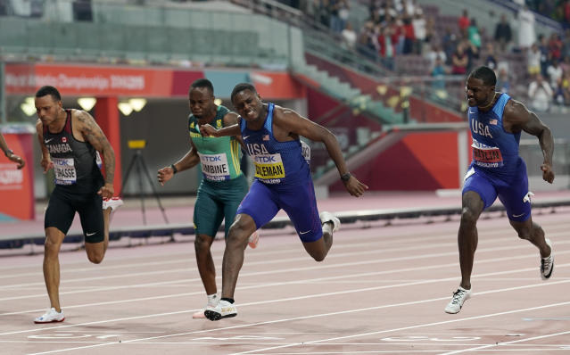 Christian Coleman, of the United States, crosses the finish line to win the men's 100 meter race ahead of silver medalist Justin Gatlin, of the United States, right, during the World Athletics Championships in Doha, Qatar, Saturday, Sept. 28, 2019.(AP Photo/David J. Phillip)