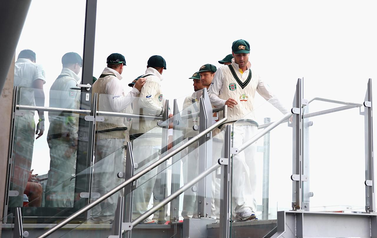 MANCHESTER, ENGLAND - AUGUST 05:  Michael Clarke of Australia leads his team onto the field during day five of the 3rd Investec Ashes Test match between England and Australia at Emirates Old Trafford Cricket Ground on August 5, 2013 in Manchester, England.  (Photo by Ryan Pierse/Getty Images)