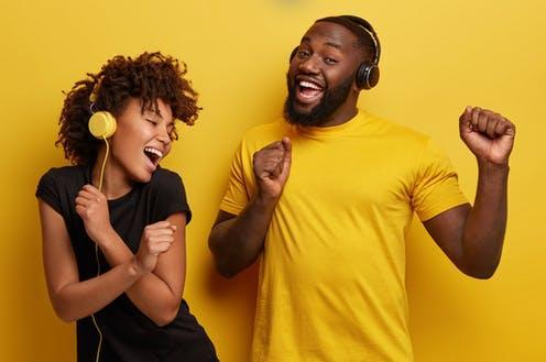 """<span class=""""caption"""">Algorithms help lots of people discover new music.</span> <span class=""""attribution""""><a class=""""link rapid-noclick-resp"""" href=""""https://www.shutterstock.com/image-photo/cheerful-young-african-american-bloggers-enjoy-1335288572"""" rel=""""nofollow noopener"""" target=""""_blank"""" data-ylk=""""slk:Shutterstock/WAYHOME studio"""">Shutterstock/WAYHOME studio</a></span>"""
