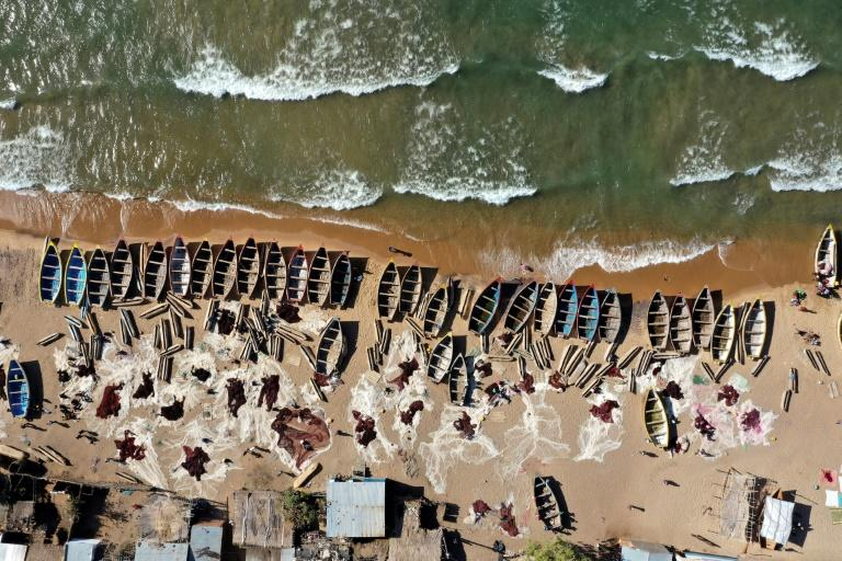 An aerial view fishing boats on the shore of the Lake Malawi at Senga Bay. The World Bank ranks Malawi among the top 10 at-risk countries in Africa to climate change