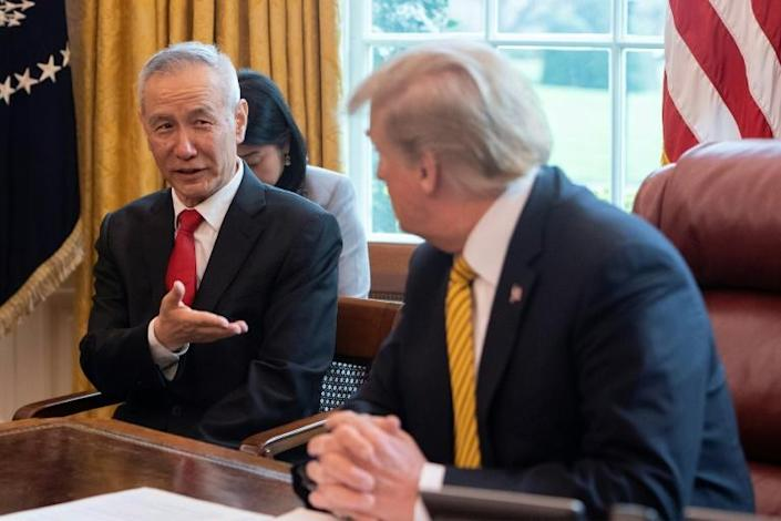 """China's Vice Premier Liu He with US President Donald Trump in 2019 is expected at the White House again for the signing of a """"phase one"""" trade deal between the two economic powers (AFP Photo/Jim WATSON)"""