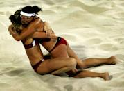 Kerri Walsh and Misty May (R) from the United States celebrate their win in the women's gold medal match on August 24, 2004 during the Athens 2004 Summer Olympic Games at the Olympic Beach Volleyball Centre at the Faliro Coastal Zone Complex in Athens, Greece. (Photo by Ian Waldie/Getty Images)