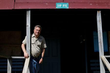 FILE PHOTO: Scott Rosmarin, owner and operator of Rosmarins Day Camp and Cottages, poses for a photograph at the Camp office in Monroe, New York, U.S., May 20, 2019. Picture taken May 20, 2019. REUTERS/Mike Segar