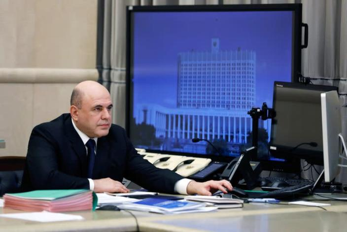 Russian Prime Minister Mikhail Mishustin chairs a meeting with members of the government via video link in Moscow