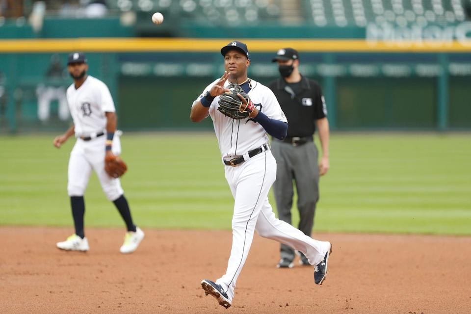 Tigers second baseman Jonathan Schoop makes a throw to first base for an out during the second inning against the Brewers on Wednesday, Sept. 9, 2020, at Comerica Park.