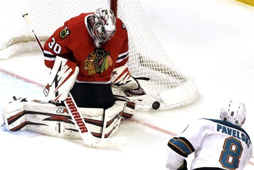 Chicago Blackhawks goalie Ray Emery (30) blocks a shot by San Jose Sharks' Joe Pavelski (8) during the third period of an NHL hockey game in Chicago, Friday, Feb. 22, 2013. The Blackhawks won 2-1. (AP Photo/Nam Y. Huh)