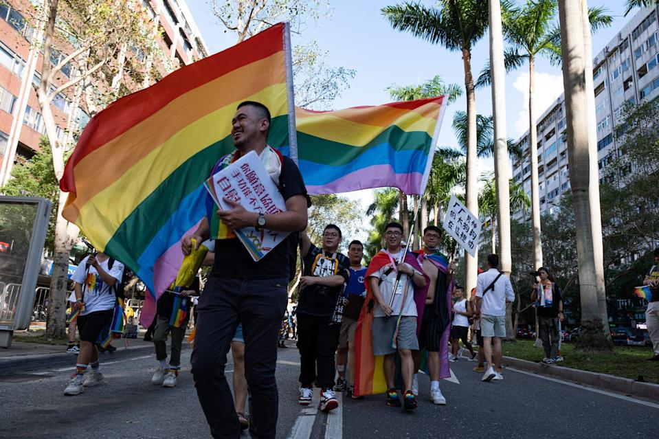Activists promoting sex positivity seen waving rainbow flags during the 2020 Taiwan pride parade.<br>(Hsiuwen Liu/SOPA Images/LightRocket via Getty)