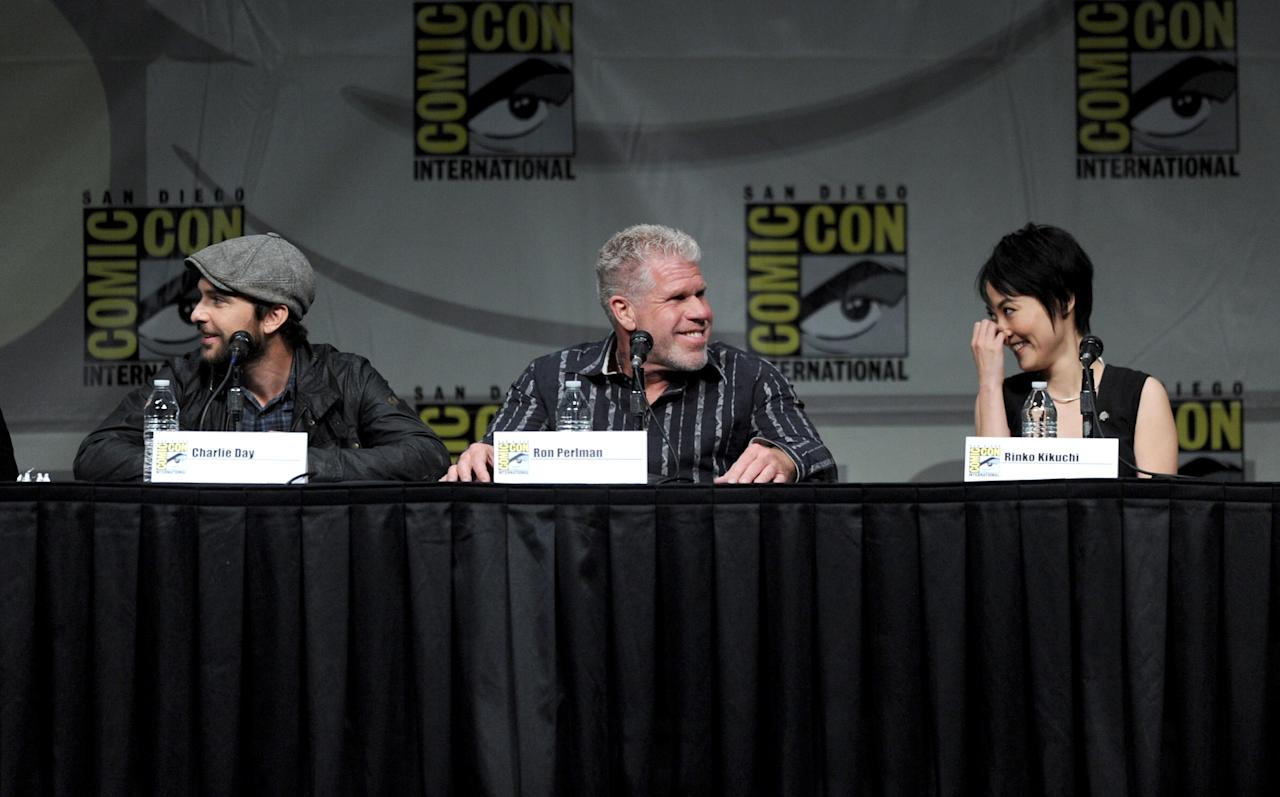 "SAN DIEGO, CA - JULY 14:  (L-R) Actors Charlie Day, Ron Perlman, and Rinko Kikuchi speak at Warner Bros. Pictures and Legendary Pictures Preview of ""Pacific Rim"" during Comic-Con International 2012 at San Diego Convention Center on July 14, 2012 in San Diego, California.  (Photo by Kevin Winter/Getty Images)"