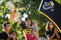Stage winner Belgium's Wout Van Aert celebrates on the podium after the twenty-first and last stage of the Tour de France cycling race over 108.4 kilometers (67.4 miles) with start in Chatou and finish on the Champs Elysees in Paris, France,Sunday, July 18, 2021. (AP Photo/Christophe Ena)