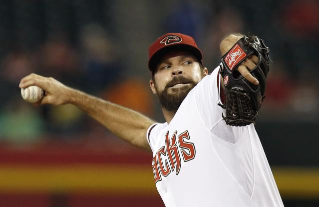 Arizona Diamondbacks' Josh Collmenter throws against the Houston Astros during the first inning of a baseball game on Monday, June 9, 2014, in Phoenix. (AP Photo/Ross D. Franklin)