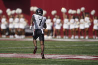 Cincinnati's Tre Tucker (7) runs back a kickoff 99-yards for a touchdown during the second half of an NCAA college football game against Indiana, Saturday, Sept. 18, 2021, in Bloomington, Ind. Cincinnati won 38-24. (AP Photo/Darron Cummings)