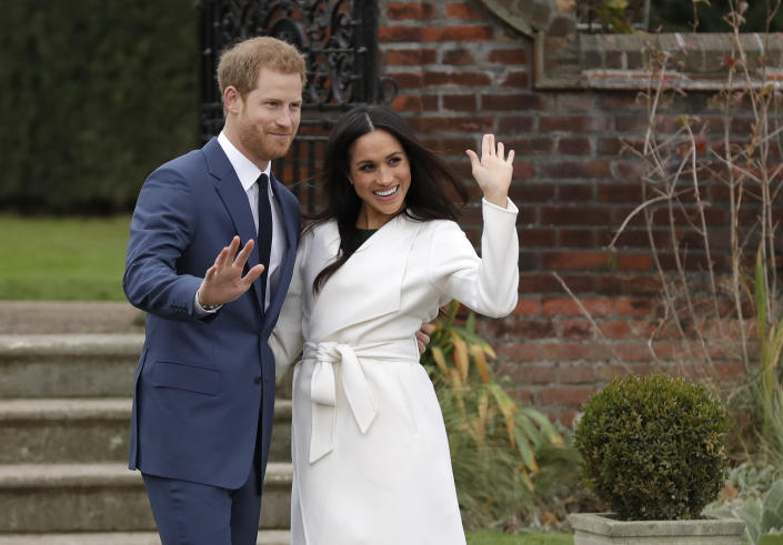 FILE - Britain's Prince Harry and his fiancee Meghan Markle pose for photographers during a photocall in the grounds of Kensington Palace in London, Monday Nov. 27, 2017. The second baby for the Duke and Duchess of Sussex is officially here: Meghan gave birth to a healthy girl on Friday, June 4, 2021. (AP Photo/Matt Dunham, File)