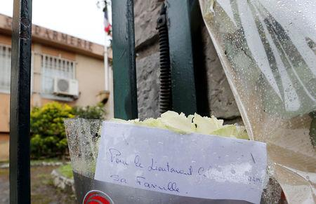 Flowers and messages in tribute to the victim are seen in front of the Gendarmerie of Carcassonne