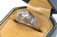 <p>Engagement rings arrived in America in the 1840s but were still relatively uncommon. In the Edwardian era (1901–1910), designs were marked by their dainty and elaborate details. Most rings centered around a large diamond and the goal of the jeweler was to get as many diamonds on the piece as possible. They would do so by encrusting small diamonds into settings made of filigree and ornate detailing sometimes resembling lace. </p>