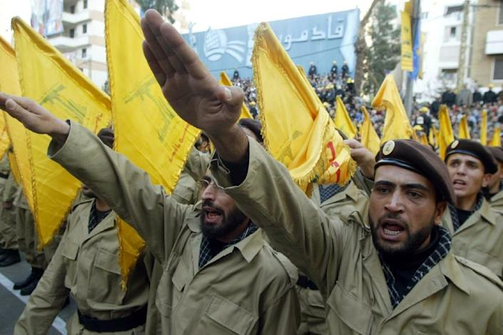 """Members of Lebanon's Shiite Muslim militant group Hezbollah parade in the streets of the southern suburbs of Beirut to mark Jerusalem Day 21 November 2003. Many Muslims celebrate the last Friday of the holy month of Ramadan as """"Jerusalem Day"""", calling for an end to Israel's 36-year occupation of the disputed holy city. AFP PHOTO/Ramzi HAIDARMembers of Lebanon's Shiite Muslim militant group Hezbollah parade in the streets of the southern suburbs of Beirut to mark Jerusalem Day 21 November 2003. Many Muslims celebrate the last Friday of the holy month of Ramadan as """"Jerusalem Day"""", calling for an end to Israel's 36-year occupation of the disputed holy city. AFP PHOTO/Ramzi HAIDAR (AFP Photo/Ramzi Haidar)"""