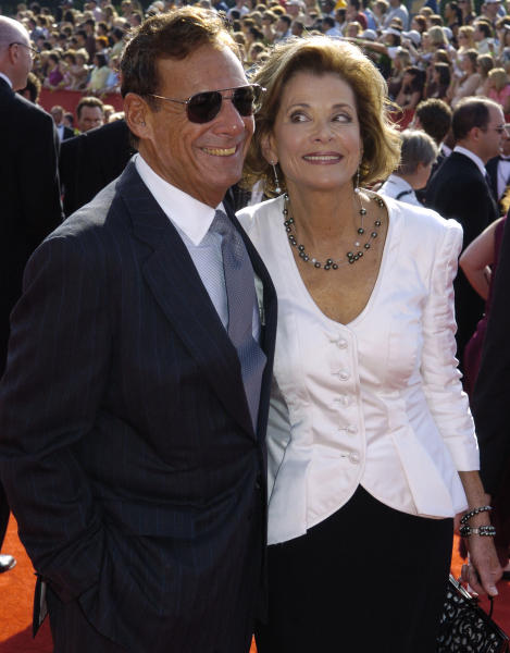 """FILE - This Sept. 18, 2005 file photo shows Ron Leibman, left, with his wife Jessica Walter at the 57th Annual Primetime Emmy Awards in Los Angeles. Leibman, who appeared in movies, theater and television in a career that spanned six decades and won a Tony for Tony Kushner's iconic play """"Angels in America,"""" has died after an illness at age 82. Leibman's agent, Robert Attermann, said the actor died Friday, Dec. 6, 2019. (AP Photo/Chris Pizzello, File)"""