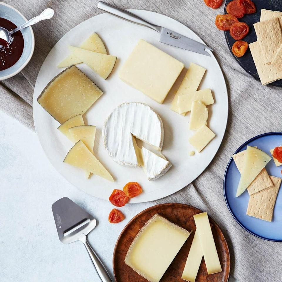 """If you're looking for the Dom Pérignon of cheese without the three-figure price tag, Murray's is where it's at. All the classics are in the mix—Gruyère, Manchego, Brie, and cheddar—plus a curation of crunchy bites and a sweet but tangy jam that even the pickiest eaters will want more of. $95, Murray's. <a href=""""https://www.murrayscheese.com/greatest-hits"""" rel=""""nofollow noopener"""" target=""""_blank"""" data-ylk=""""slk:Get it now!"""" class=""""link rapid-noclick-resp"""">Get it now!</a>"""