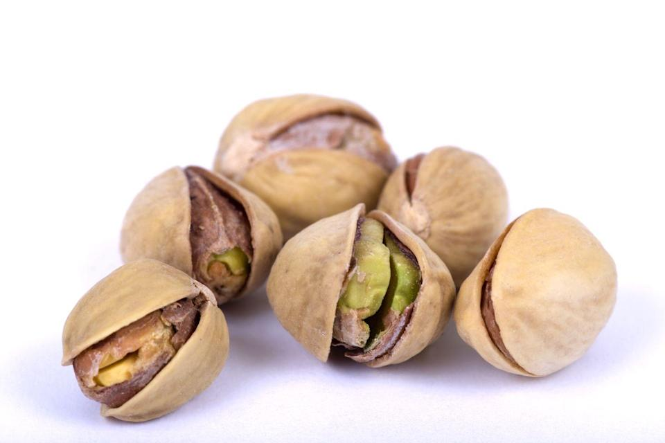 """<p><strong>Just having to crack the shell open on pistachios can help you slow down and eat a bit more mindfully, </strong>which can lead to better portion control. <a href=""""https://americanpistachios.org/research-archives/weight-research"""" rel=""""nofollow noopener"""" target=""""_blank"""" data-ylk=""""slk:Research"""" class=""""link rapid-noclick-resp"""">Research</a> shows that individuals ate 41% more calories worth of nuts when eating the no shell variety vs the in shell option.</p>"""