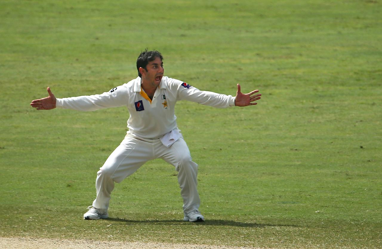 Saeed Ajmal of Pakistan celebrates taking the wicket of Vernon Philander of South Africa during the third day of the second Test cricket match between Pakistan and South Africa in Dubai on October 25, 2013.      AFP PHOTO/MARWAN NAAMANI        (Photo credit should read MARWAN NAAMANI/AFP/Getty Images)