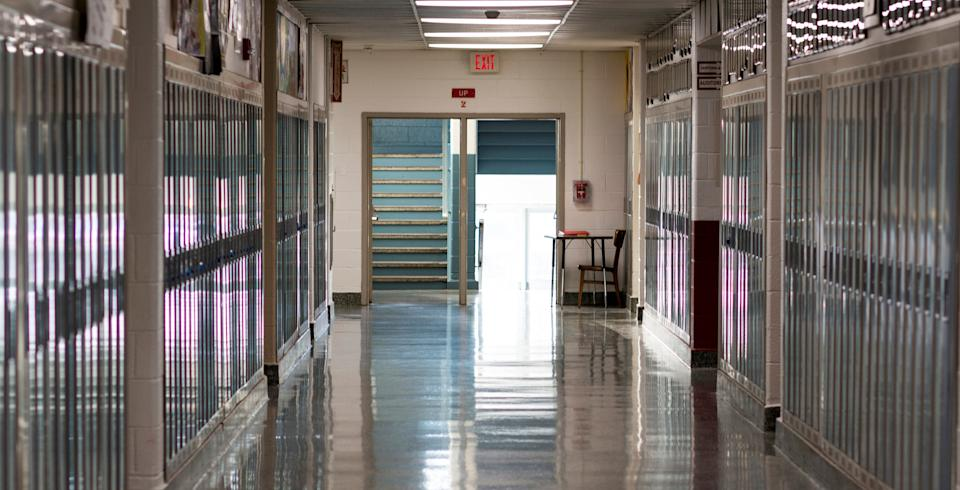 A high schools empty hallway because school is closed due to the caronavirus in March 2020. (Photo: WoodysPhotos via Getty Images)