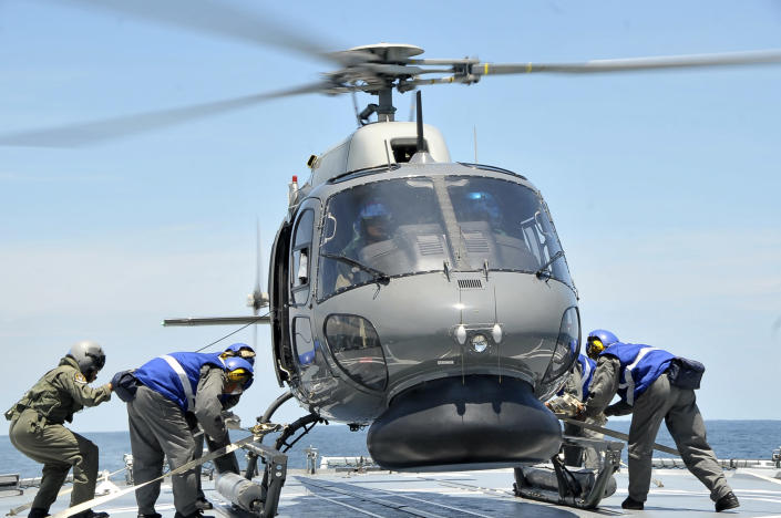 In this photo released by The Royal Malaysian Navy, a Royal Malaysian Navy Fennec helicopter prepares to depart to aid in the search and rescue efforts for the missing Malaysia Airlines plane over the Straits of Malacca, Malaysia, Thursday, March 13, 2014. Planes sent Thursday to check the spot where Chinese satellite images showed possible debris from the missing Malaysian jetliner found nothing, Malaysia's civil aviation chief said, deflating the latest lead in the six-day hunt. The hunt for the missing Malaysia Airlines flight 370 has been punctuated by false leads since it disappeared with 239 people aboard about an hour after leaving Kuala Lumpur for Beijing early Saturday. (AP Photo/The Royal Malaysian Navy)