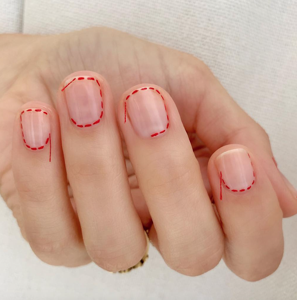 """Copy nail artist Betina Goldstein and glue leftover string from a sewing kit at the ends of your """"stitches"""" to play up the creepy Coraline vibes."""