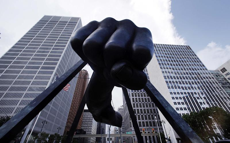 """The Detroit skyline rises behind the Monument to Joe Louis, also known as """"The Fist,"""" Thursday, July 18, 2013. State-appointed emergency manager Kevyn Orr asked a federal judge permission to place Detroit into Chapter 9 bankruptcy protection. (AP Photo/Paul Sancya)"""