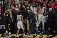 The Philadelphia 76ers and the Atlanta Hawks are separated after a brief scuffle during the second half of Game 6 of an NBA basketball Eastern Conference semifinal series Friday, June 18, 2021, in Atlanta. (AP Photo/John Bazemore)
